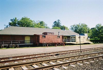 Old Greenport Station (Caboose and Plow), image released to public domain by its author